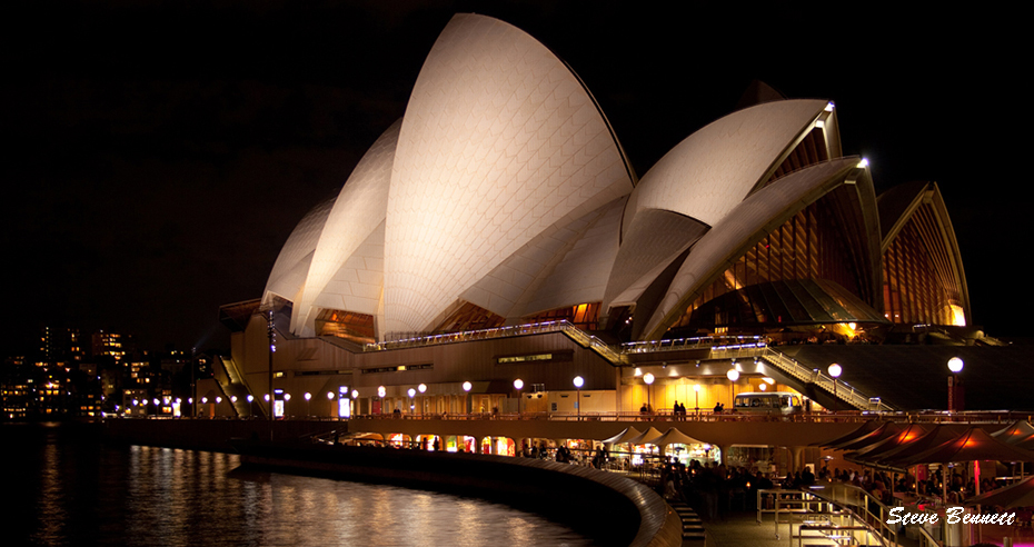 Sydney Opera House at Circular Quay at night with reflection on water